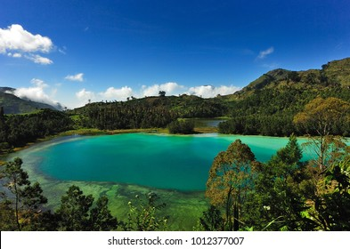 Dieng Plateau. Telaga warna sulphur lake at Indonesia. Beautiful landscape.
