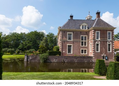 DIepenheim,holland,11-08-2021:castle warmelo with reflection in the water, the garden of the castle is used for a anual sand sculpture statute competition