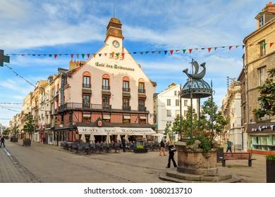 Dieppe, France - August 2, 2014: Tourists visit downtown Dieppe, France, on a summer day on August 2, 2014