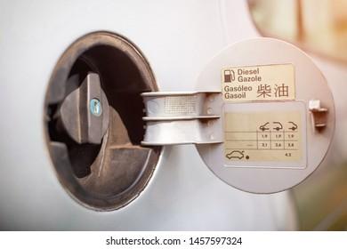 Diesel car gas tank cap, concept of diesel scandal and ban on diesel cars. Diesel quality, heavy fuel