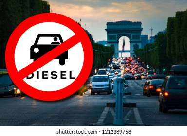 Diesel car Prohibition sign and Paris street with busy traffic blurred on the background. Symbolizing that Paris will be among the first European cities to ban diesels in 2024