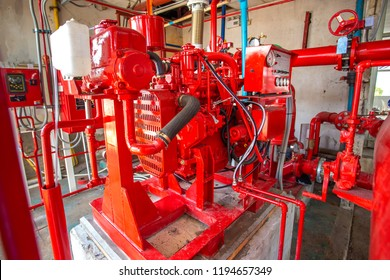 Diesel engine fire pump, Industrial fire extinguishing system with control system red piping and valve.