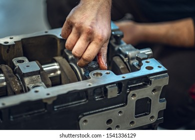 Diesel engine under repair in a professional service. Verification by a qualified mechanic