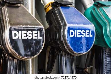 Diesel fuel pistols on a gas station refueling stand. Detailed macro photo for oil business, truck, airplane and car transportation or ecological theme background