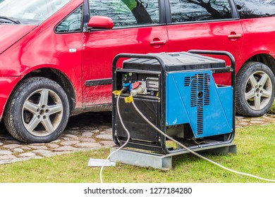 Diesel generator produces electricity and a red car