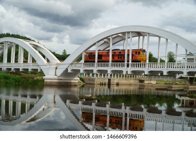Diesel locomotive passing the Tha Chom Phu railway bridge or white bridge, railway bridge in Mae Tha District, Lamphun, landmark of northern Thailand