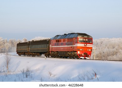 Diesel locomotive TEP70-0350 with passenger train in Novgorodskaya region, Russia