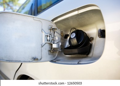 A diesel tank on a car open and ready for filling