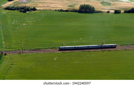A diesel train engine on an electrified railroad