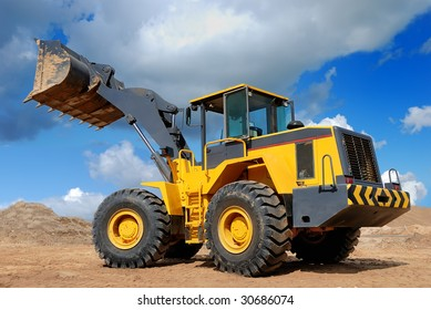 diesel wheel loader with risen bucket outdoors