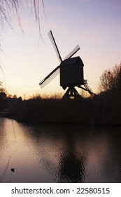 Diest - windmill at lake during sunset - back view