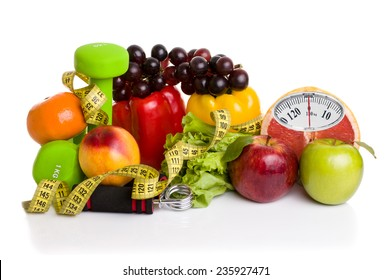 Diet concept. Fitness equipment, healthy food with weight scale isolated on white background