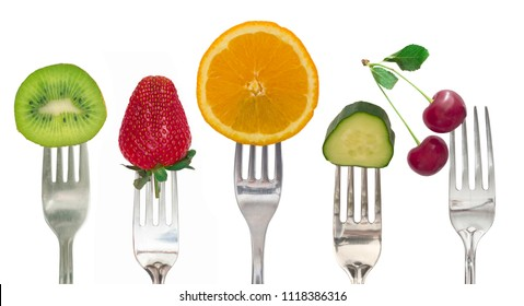 diet concept, fresh fruit and vegetables on the fork isolated on white background