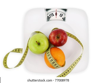 Diet concept. Fruits with measuring tape on a plate like weight loss scale