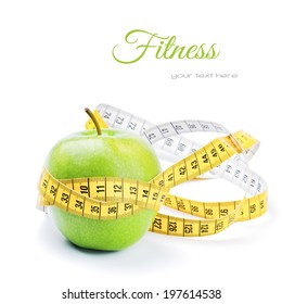 Diet concept with green apple and measuring tape