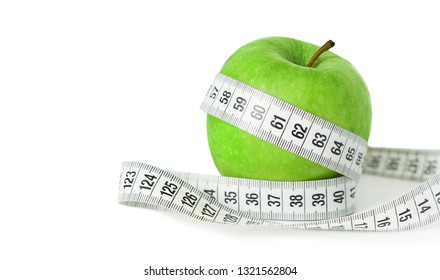 Diet concept with a green apple wrapped by a measuring tape on white background with copyspace.