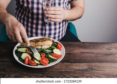 Diet concept, healthy lifestyle, low calorie food. Dieting. Closeup portrait of man eating healthy food