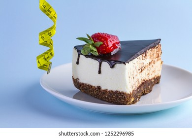 Diet concept. High-calorie, carbohydrate, sweet food. The choice between strawberry cake with chocolate icing and a sporty lifestyle, slim figure. Harmful food