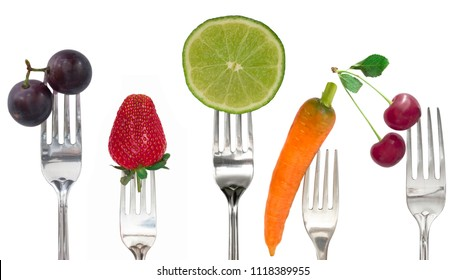 diet concept, vegetables and fruit on the forks isolated on the white background