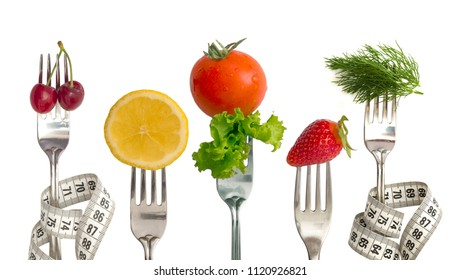 Diet Concept, vegetables and fruit on the forks isolated on white
