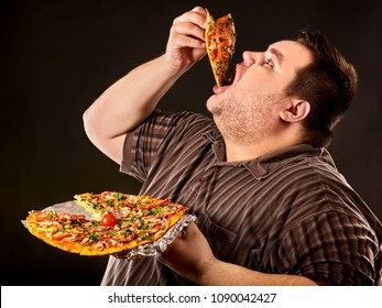 Diet failure of fat man eating fast food slice pizza on plate. Close up of breakfast for hungry overweight person who spoiled healthy food. He can not give up harmful food.