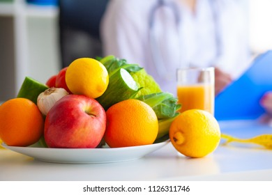 Diet. Fitness and healthy food diet concept. Balanced diet with vegetables. Concept of natural food and healthy lifestyle.