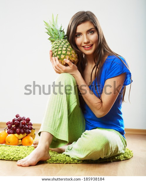 Diet food concept. Woman sitting on a floor near tropical fruit.