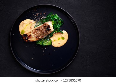 diet food, proper nutrition, seafood, vegetarian, pescetarian. grill pub and fish restaurant menu, delicious pikeperch with spinach garnishing and sauce, grilled zander