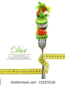 Diet  fresh mixed vegetables on fork with measuring tape
