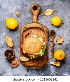 Diet hamburger with fresh vegetables and pumpkin cutlet.Fast food dish