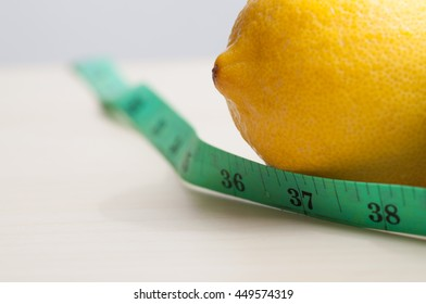 Diet and Health concept. Green apple and measuring tape