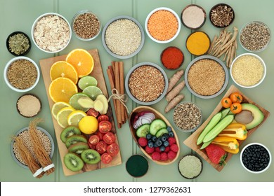 Diet health food for liver detox with fresh fruit, vegetables, herbal medicine, legumes, grains, seeds, herbs and spices. Foods high in antioxidants, omega 3, vitamins &  dietary fibre. Top view.