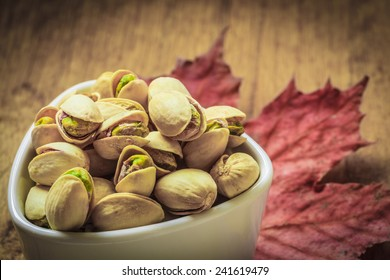 Diet healthcare concept. Roasted pistachio nuts seed with shell close up