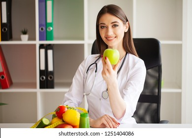 Diet and Healthy concept. Smiling nutritionist in her office.