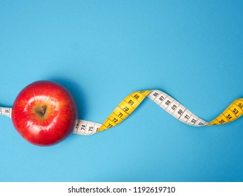 Diet or healthy eating concept with a measuring tape