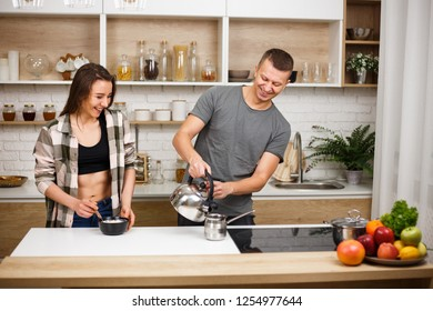 diet, healthy eating, fitness lifestyle, proper nutrition. health conscious couple cooking together in home kitchen