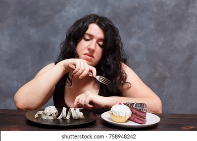 Diet, healthy eating, weight loss and slim body concept. Overweight girl choosing between sweets and measuring tape, young woman bored of dieting