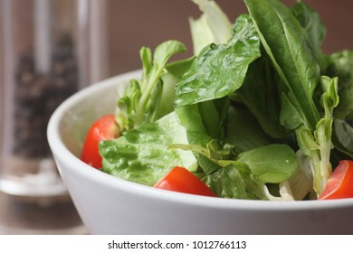 Diet and healthy food, Vegetable salad, tomato, lettuce, cucumber, Japanese bean sprout, in white bowl.