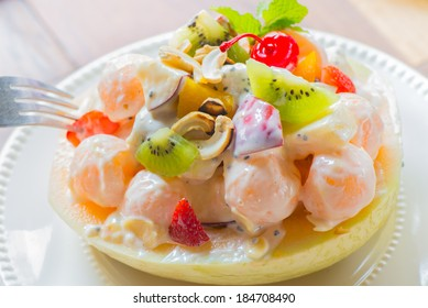 Diet, healthy fruit salad in the white bowl - healthy breakfast, weight loss concept