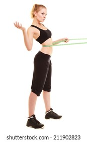 diet and healthy lifestyle. slim fit smiling blonde girl young woman with green measure tape measuring her waist isolated on white
