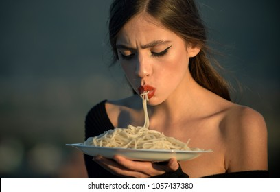Diet and healthy organic food, italy. Chef woman with red lips eat pasta. Hunger, appetite, recipe. Woman eating pasta as taster or restaurant critic. Italian macaroni or spaghetti for dinner, cook.