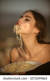 Diet and healthy organic food, italy. Italian macaroni or spaghetti for dinner, cook. Chef woman with red lips eat pasta. Hunger, appetite, recipe. Woman eating pasta as taster or restaurant critic.