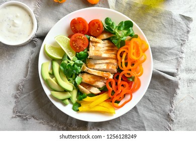 Diet healthy vegetable salad with roasted chicken breast. Close up view