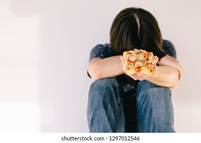 Diet men feeling sad on white background, Can't eat pizza. Diet ,Healthy food.