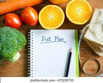 Diet plan notebook and vegetables with copy space for healthy food concept.