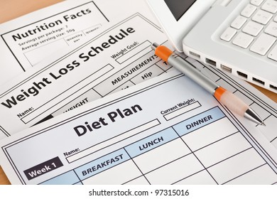 Diet Plan and Weightloss Schedule by Laptop on Table