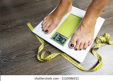 Diet recommendation with woman legs on weighting scale