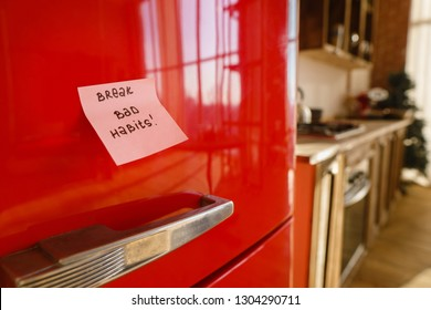 diet, self control, challenge and motivation. closed fridge with break bad habits note. proper nutrition and healthy lifestyle