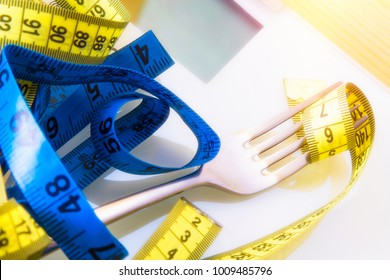 Diet and slimming concept. weighing scale and metric tape