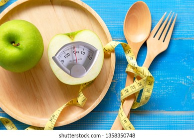 Diet slimming. Green apple with weight scale and measuring tape for balance body weight loss in healthy car. Diet and Healthy Concept